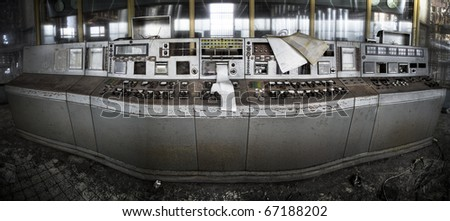A panoramis picture of an abandoned controle room - stock photo