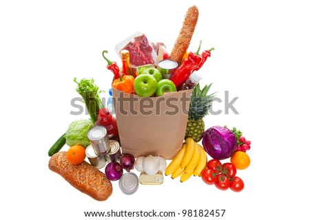 A paper bag full of groceries, surrounded by fruits, vegetables, bread, bottled beverages, and canned goods. studio isolated on white background. - stock photo