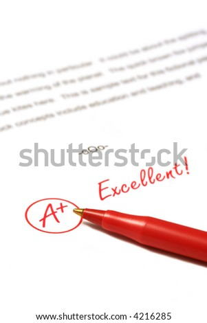A paper is graded A Plus, Excellent, with red pen. - stock photo