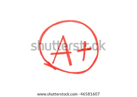 A paper is graded A Plus, Excellent, with red pen - stock photo