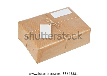 A parcel wrapped in brown paper and tied with rough twine and two blank labels, isolated on white background. Path included and shallow depth of field - stock photo