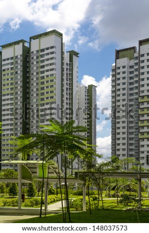A park leading to a green estate in Singapore. - stock photo