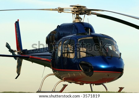 A parked Helicopter. - stock photo