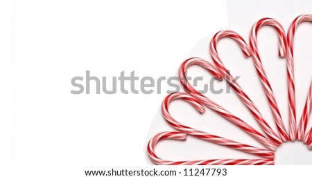 A partial circle of candy canes - stock photo