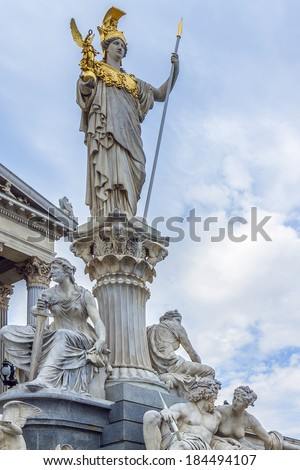 A particular of Athena Fountain (Pallas-Athene-Brun nen) in front of Austrian Parliament Building. Figures symbolize most important rivers of the Austro-Hungarian Empire. It was completed in 1902. - stock photo