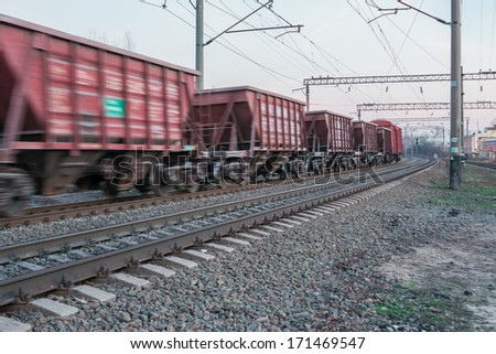 a passing freight train at a speed of - stock photo