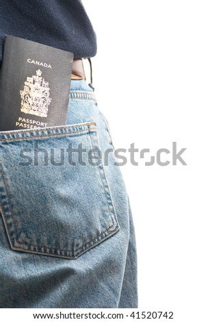 A passport sticking out of a man's back pocket, isolated on white. - stock photo