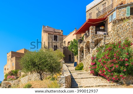 A path to traditional restaurant built from stones in medieval village of Sant Antonino, Corsica island, France - stock photo