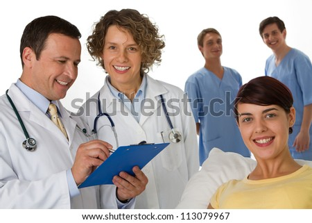 A patient being visited by a doctor and nurse - stock photo