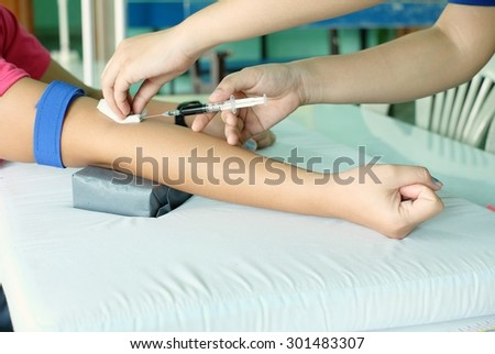A patient receiving an injection from a syringe,Close up - stock photo