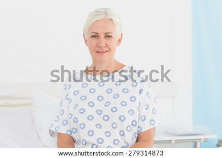 a patient waiting for a doctor in the examination room - stock photo