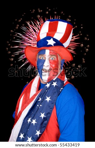 A patriotic man dressed in red, white and blue with fireworks in the black sky. - stock photo