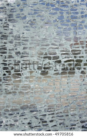 a pattern created by some broken cracked glass - stock photo