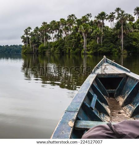 A peaceful moment in a boat at Lake Sandoval, South America, Peru, Peruvian Amazon. Madre de Dios. - stock photo