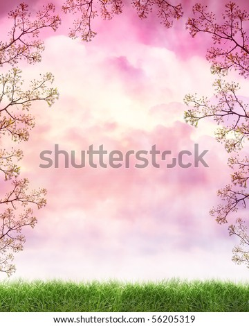 A peaceful nature cloud background with pink and violet light from a sunset. There is a frame or border of flowers growing from a tree. Grass is on the bottom. - stock photo