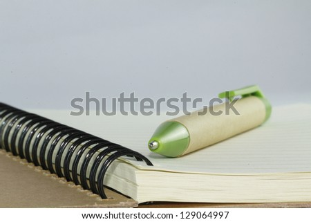 A pen and notebook, closeup - stock photo