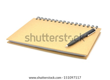 a pen on notebook isolated on white background  - stock photo
