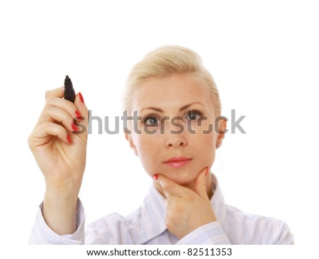 A pensive businesswoman writing with a marker, isolated on white - stock photo