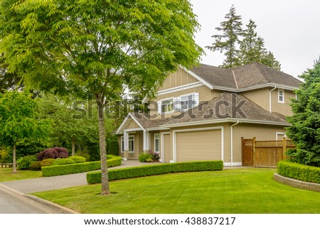 A perfect neighborhood. Houses in suburb at Spring in the north America. - stock photo