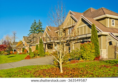 A perfect neighborhood. Houses with outdoor landscape in suburb at Fall in the north America - stock photo