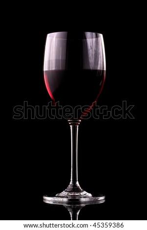 A perfect seductive glass of wine - stock photo