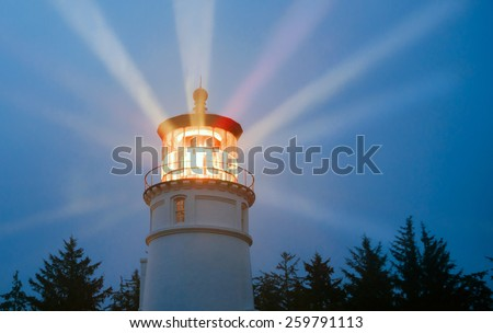 A perfect storm is just the right weather to make a lighthouse earn its keep for weary travelers - stock photo
