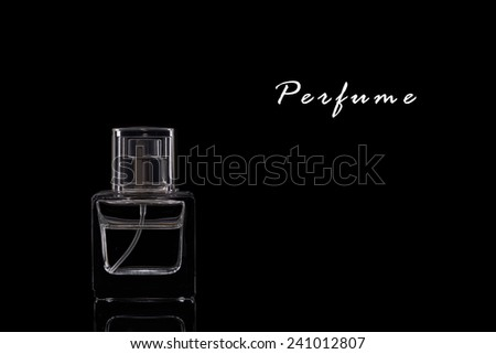 A Perfume Bottle on a Black Background.Copy Space.  - stock photo