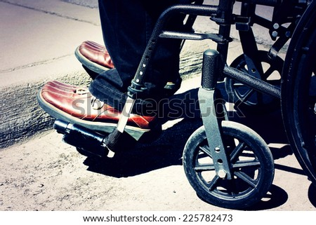 A person in a wheelchair - stock photo