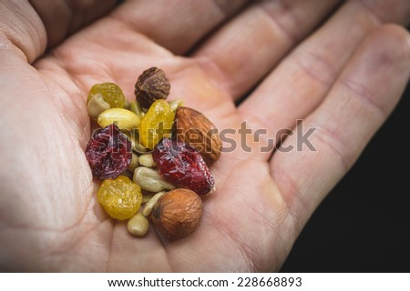 a person sharing some healthy trail mix - stock photo