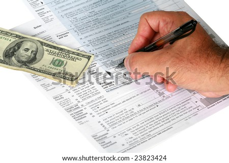 a person signs us tax forums with a payment or tax return isolated on white - stock photo