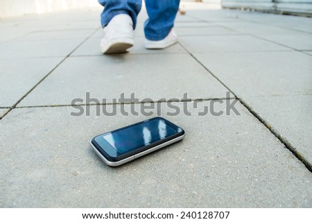 a person who loses the phone and falls in a city - stock photo