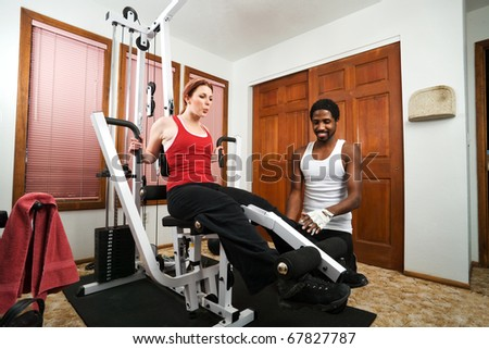 a personal trainer gives instruction on weight lifting - stock photo