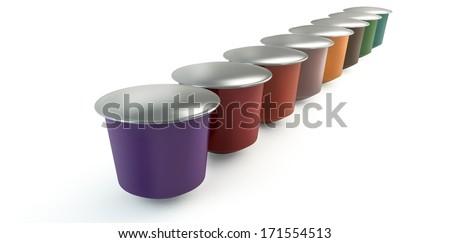 A perspective view of a collection of colorful instant espresso coffee capsules sealed with foil in a neat line on an isolated white background - stock photo