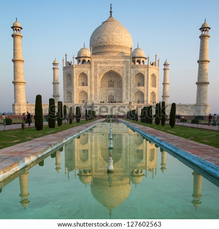 A perspective view on Taj Mahal mausoleum with reflection in water. Agra, India. - stock photo