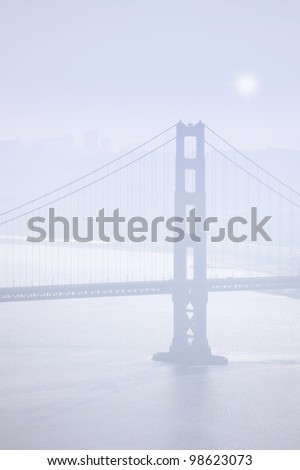 A photo a The Golden Gate in early morning fog - stock photo