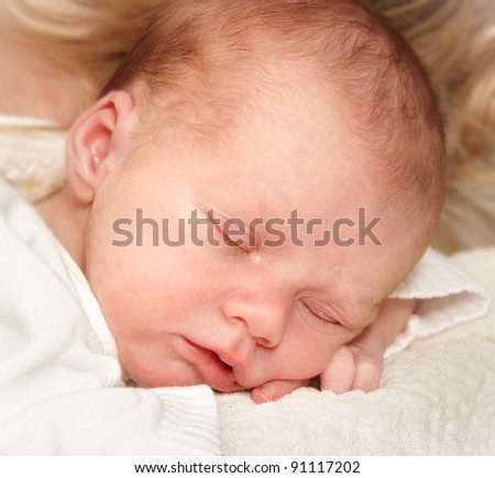 A photo of a beautiful newborn baby boy with mother - stock photo