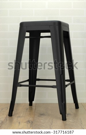 A photo of a black metal stool - stock photo