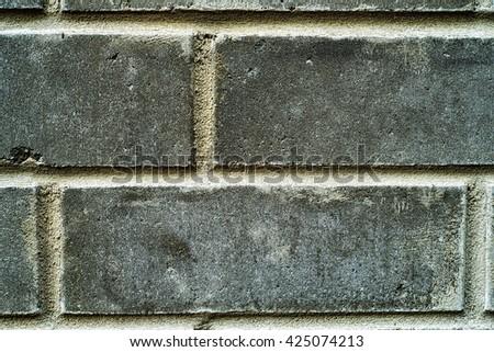 a photo of a brick wall. - stock photo