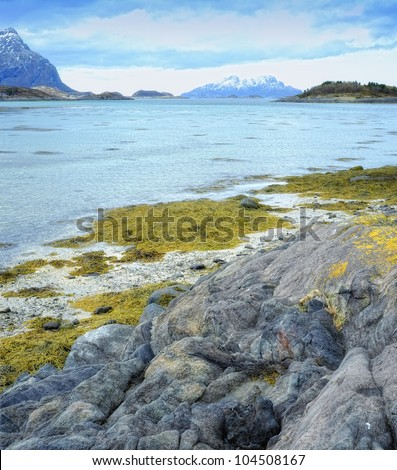 A photo of a fjord north of the polar circle in Norway - stock photo