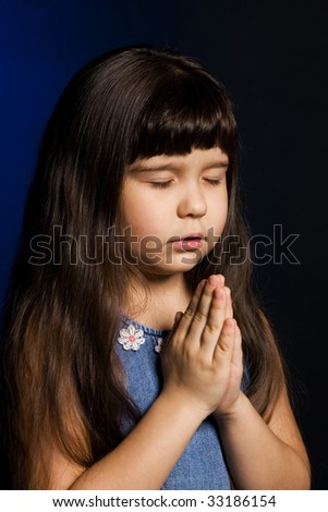 A photo of a girl, praying, isolated - stock photo