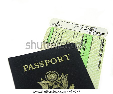 A photo of a passport and airplane ticket - stock photo