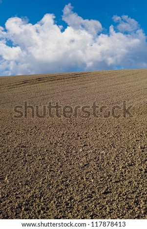 A photo of a plowed field - stock photo