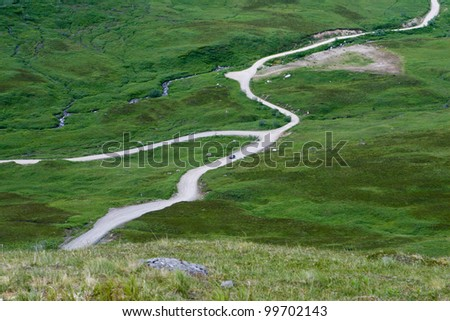 A photo of a road winding through the Alaskan tundra - stock photo