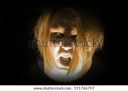 A photo of a zombie with bright yellow zombie eyes - stock photo