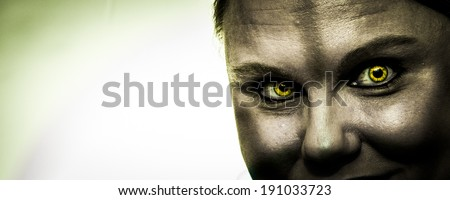 A photo of a zombie with bright yellow zombie eyes; white panoramic format - stock photo