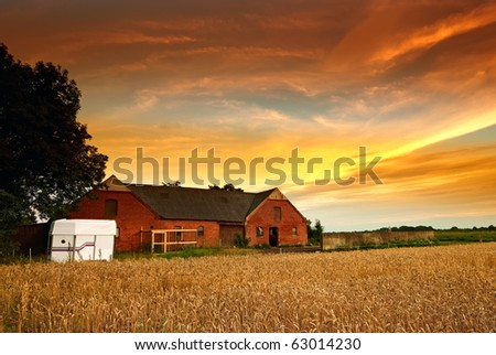 a photo of an old Danish farm in sunset - stock photo