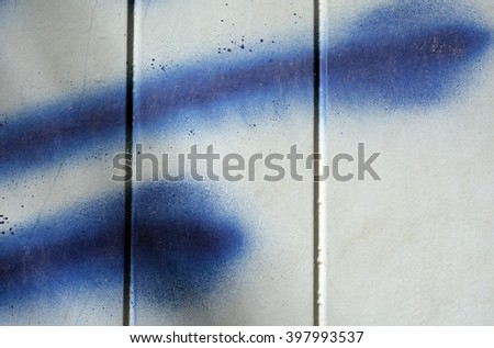 a photo of blue paint spatter on a metal door - stock photo