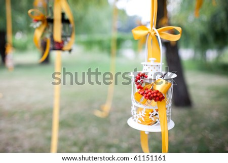 A photo of decorated wedding tree and candles - stock photo