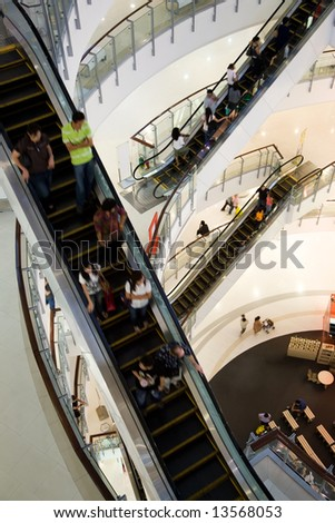 A photo of escalators in the shopping mall - stock photo