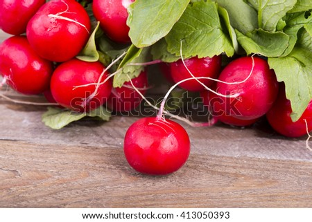 a photo of fresh red radishes - stock photo
